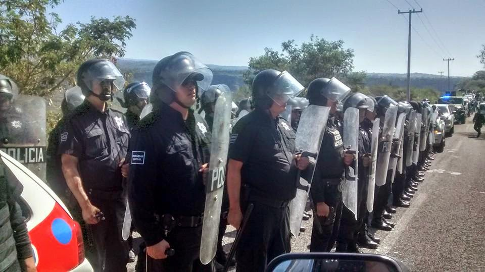 The state of Colima did everything possible to ensure that an International and National Observation Mission could not visit the Nahua Indigenous community of Zacualpan during their visit in early 2015. Police were sent out in menacing numbers, along with a small tank, after the Governor's office had told the mission that its way to the community was supposedly clear. Photo: MiningWatch