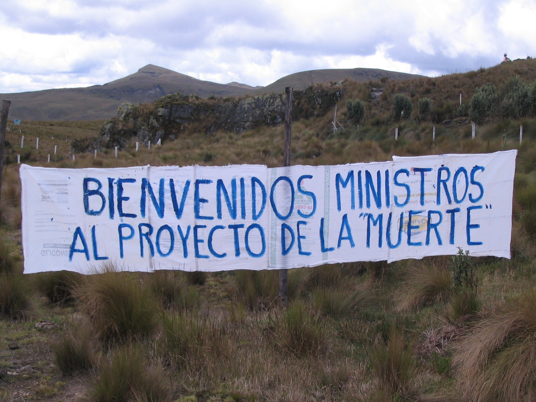 """For more than a decade, downstream communities have opposed a proposed gold and silver project that belongs to INV Metals (originally IAMGOLD) in defence of their water supplies and the páramo known as Kimsacocha. Banner reads: """"Welcome Ministers to the Project of Death."""" Photo: MiningWatch"""