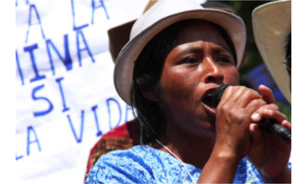 Crisanta Pérez speaks into a microphone at a protest against mining in Guatemala