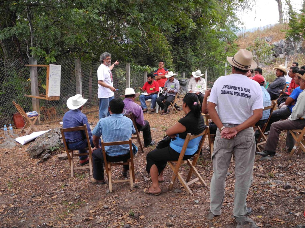 image of a community meeting with Gustavo Castro in Chiapas, Mexico
