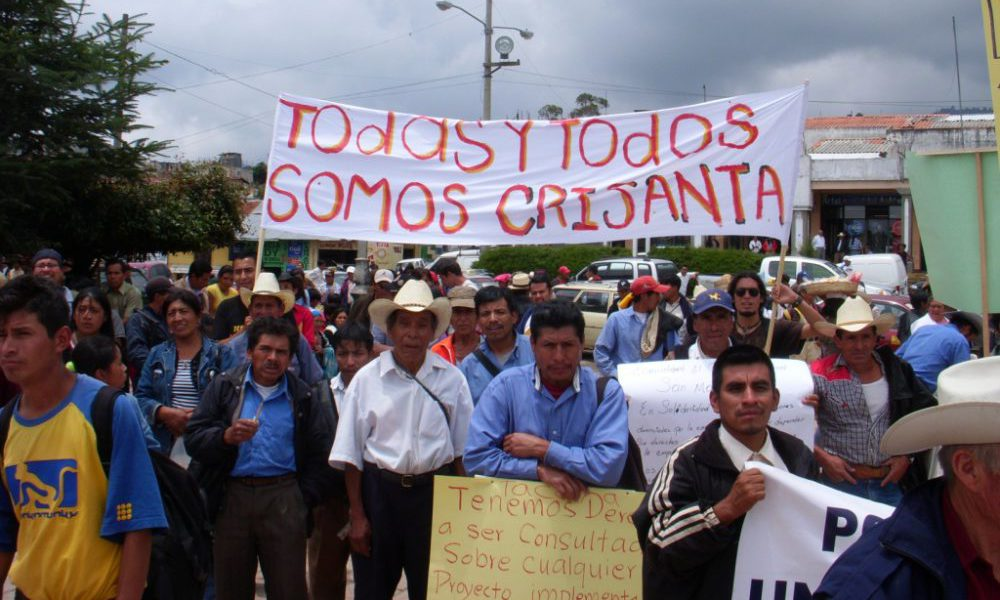 a crowd of people around a banner that says 'we are all Crisanta' in Spanish