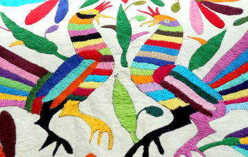 a bright, multicoloured tapestry of two birds