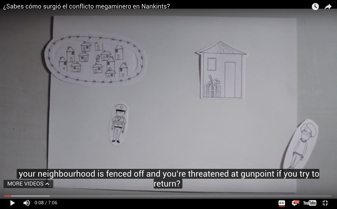 A screenshot of a YouTube video about a mining conflict in Ecuador. An English caption reads: 'your neighbourhood is fenced off and you're threatened at gunpoint if you try to return.'